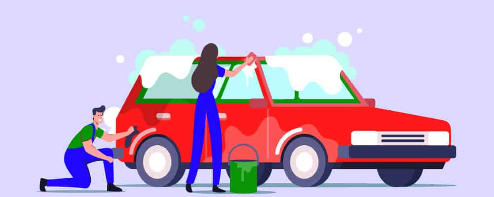Man and woman cleaning their car